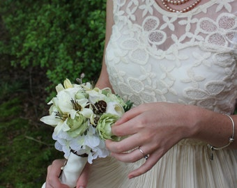 Pale greens and white, Ranunculus, Lily, Hydrangea, twigs, pinecones Bouquet  by KgDesign
