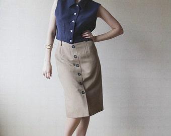 Navy blue button up sleeveless shirt blouse.