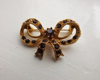 Gold Bow Brooch with Purple Diamonte Stones