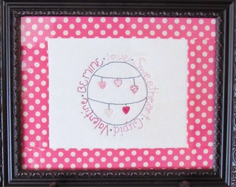 5x7in valentine hand embroidery in shades of pink.  Cute circle with hanging hearts design for fun February home decor.