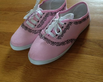 Pink keds with sharpie designs