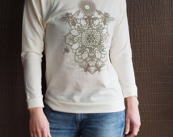 Bee Mandala Printed in Latte Brown on an Ivory Next Level Raw Edge 3/4 length sleeve wide neck sweatshirt