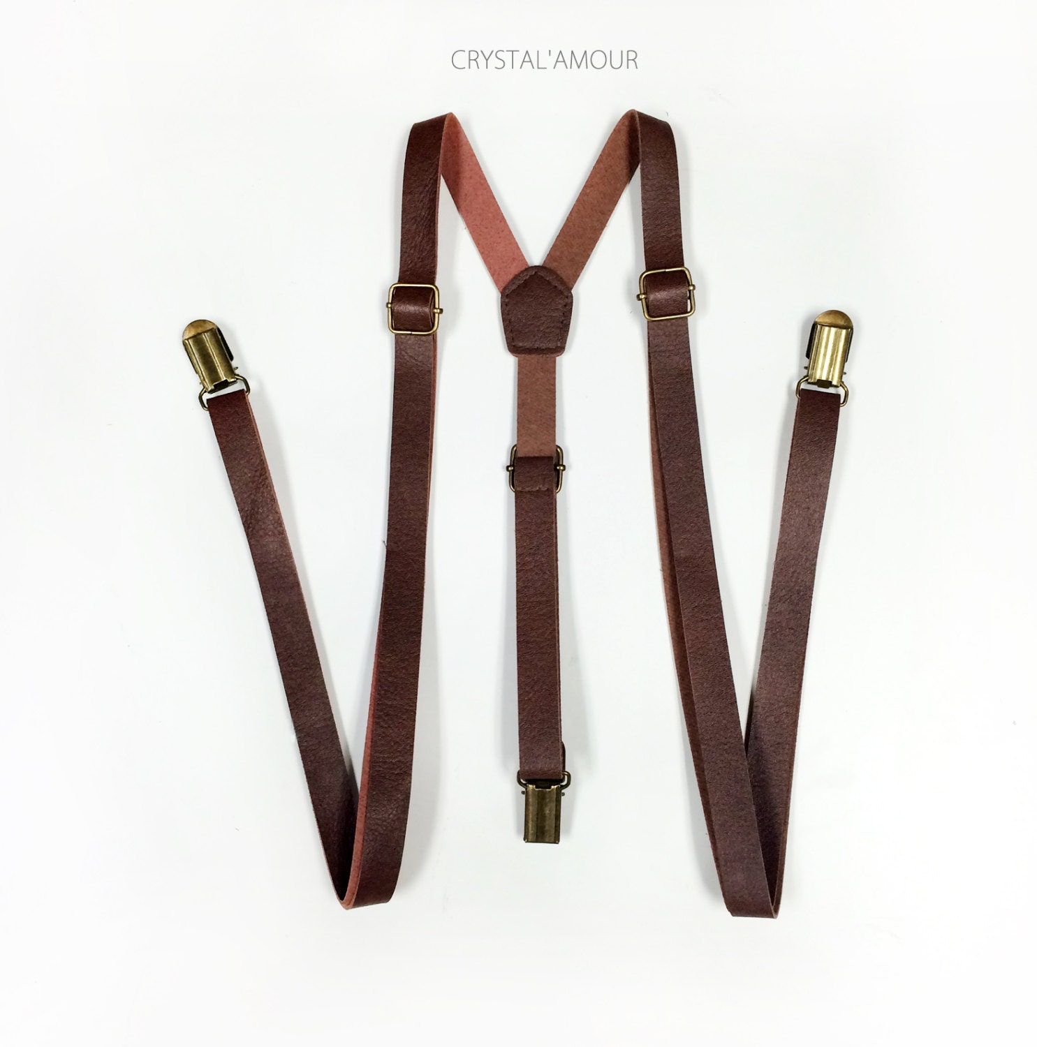 Most of our casual and dress leather suspenders come in either black or brown leather and in a choice of attachment styles including finger clip or button. No matter what your style objective, you will find the perfect pair of leather suspenders in our collection.