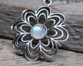 Snowflakes necklace ... cast sterling silver openwork snowflake with blue fire rainbow moonstone