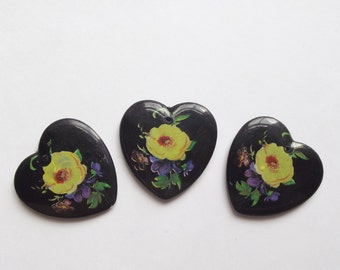 Vintage black plastic heart pendants