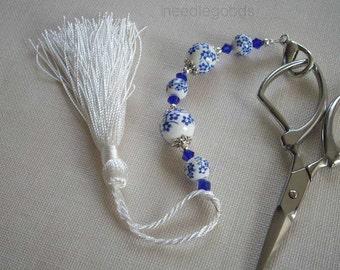 Blue flowers on white porcelain beaded scissors fob with white tassel