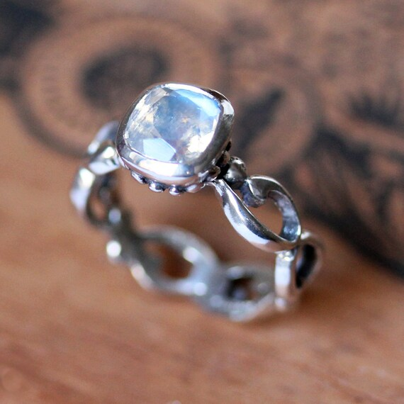 Moonstone Engagement Ring Rainbow Moonstone Ring Cushion Cut. $100 Wedding Rings. Sun Wedding Rings. White Wedding Rings. Biblical Wedding Rings. Sapphire Engagement Rings. Ashley Hebert Engagement Rings. Morganite Rings. Jasmine Engagement Rings