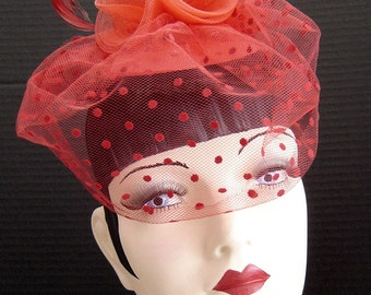 Red Cocktail Hat Fascinator With Dotted Netting And Black Ruffle