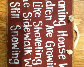 Cleaning house while children growing shoveling sidewalk while snowing sign