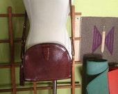 1980's leather vintage chestnut colored purse.