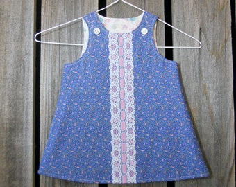Baby dress in size 3 to 6 months (blue lace front made from reclaimed materials)
