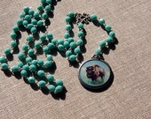 buffalo and deer double sided lavaliere necklace with turquoise glass beads