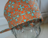 Tie Back Surgical Scrub Hat with Orange Turquoise Medallion