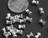 50 pcs of antique Silver bow spacer beads 6x4mm