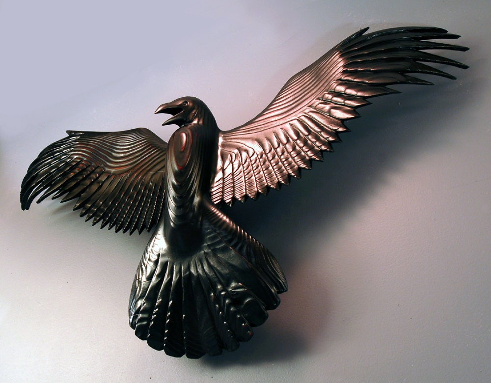 Raven wood carving by jason tennant