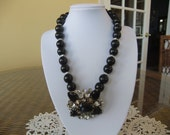 Black Beaded Necklace with Vintage Rhinestone Brooch as Focal Point