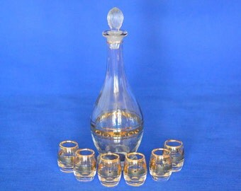 Vintage Clear Glass Liquor Decanter with Six Glasses and Gold Accents