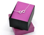 Infinity necklace handmade in sterling silver. Minimalist infinity pendant perfect for everyday wearing.