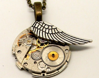 Steampunk jewelry. Steampunk watch with angel wing pendant necklace.