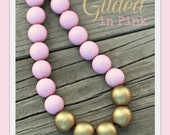 Gilded in pink beaded color blocked gold and pink necklace