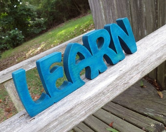 wood learn sign shelf sitter or wall hanging choice of colors