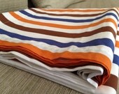 Table cloth strip orange blue and brown