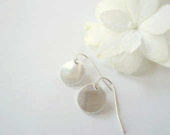 Small silver drop earrings. Silver drops. Silver circle earrings. Silver dot earrings. Tiny sterling discs. Small sterling silver dangles.