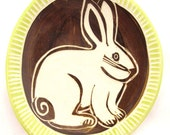 White Bunny Dish with Chocolate Colored Background