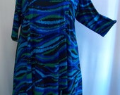 Coco and Juan Plus Size Asymmetric Tunic Top Turquoise Waves  Print Poly Knit Size 1 (fits 1X,2X)   Bust 50 inches