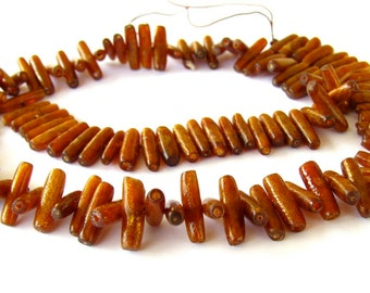 Gold Coral Stick Beads - 15.5 inch strand of 12x3mm beads