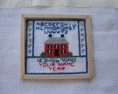 Doll House miniature cross stitched sampler.