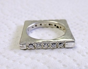 This is a 3 to 3.5mm Sterling band with White Topaz set in the ring RF613