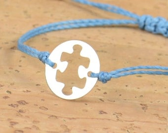 Sterling silver puzzle piece shaped charm bracelet