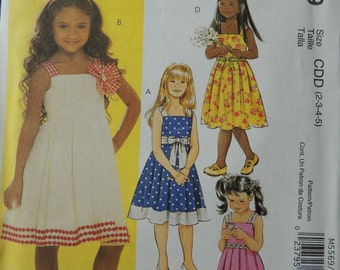 McCalls M5569 Children's and Grils Dresses and Sash in sizes 2-3-4-5 (uncut)