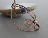 Swirly ornate shawl pin or scarf pin with wrapped indigo blue lapis stone