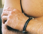 Man and womans leather and sterling silver bracelet.