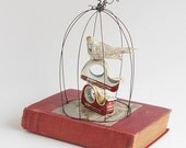 Sweet Bird Music - Paper Mache Bird in a Bird Cage - Altered Book Assemblage