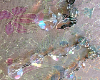 Two AB crystal clip ons