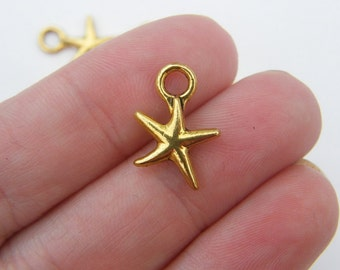14 Starfish charms antique gold tone GC23