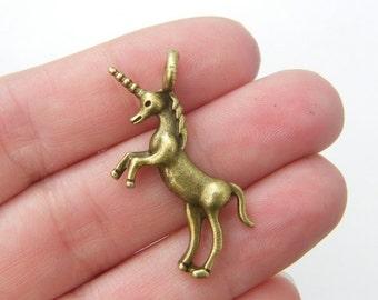 5 Unicorn Charms antique bronze tone BC121