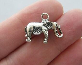 4 Elephant charms antique silver tone A520