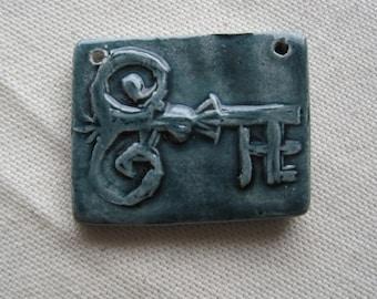 ornate skeleton key carved ceramic pendant focal glossy blue grey