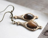 faerie earrings. (antique brass filigree. ornate setting. brown tigers eye gemstone. smooth cabochon. dangle french hooks. victorian))