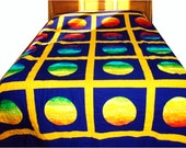 Queen Sized Quilt Portholes in Rainbow Color Gradation on Cobalt Background