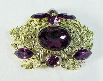 Purple Rhinestone brooch Ornate Leaf Design Unsigned