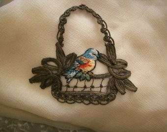 Antique metal appliqué with beautiful bird embroidery made of metal and cotton