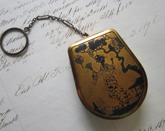 vintage brass compact with Asian motif - chain - rouge compartment, mirror, and lipstick - patente 1926