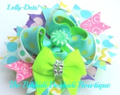 Bright Polka dot hair bow with Lolly pop centre