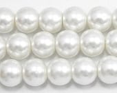 """12mm Ivory-2 Glass Pearl Beads - One 16"""" strand."""