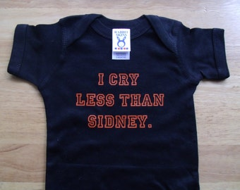 I cry less than sidney onesie Now in orange print!